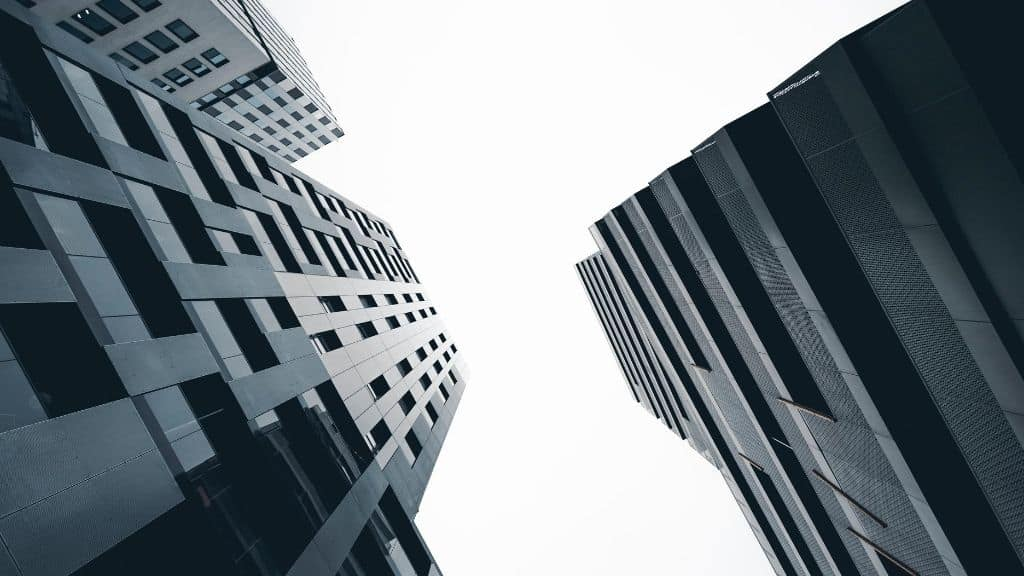 tall buildings looking up at sky from ground