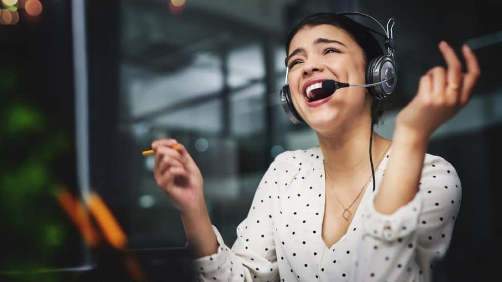 overjoyed happy woman in white shirt with headset