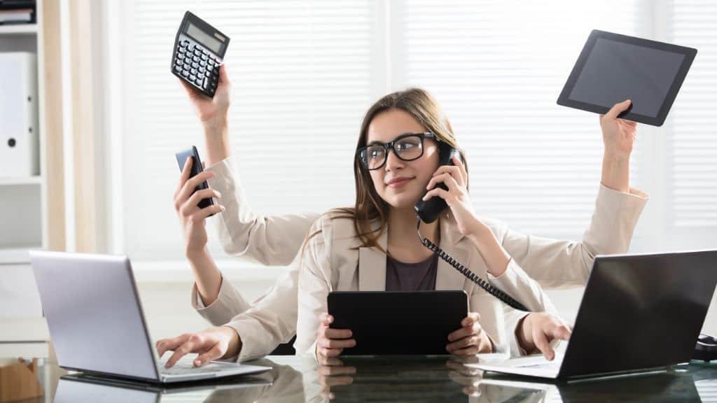 single tasking header woman multitasking at desk