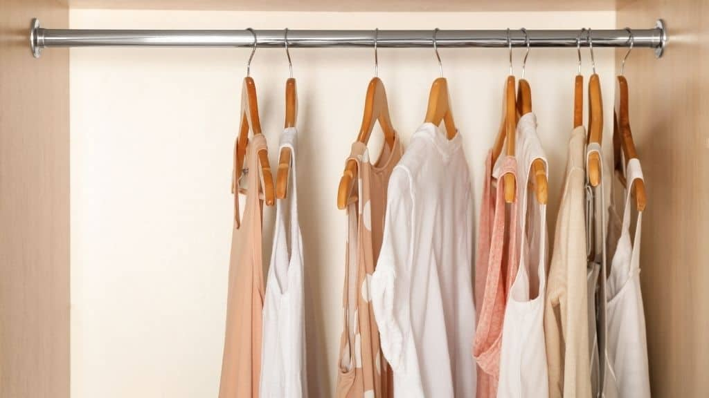 white and pink shirts in minimalist closet